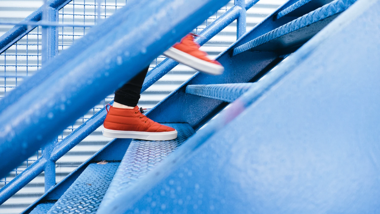 Photograph of feet walking up stairs